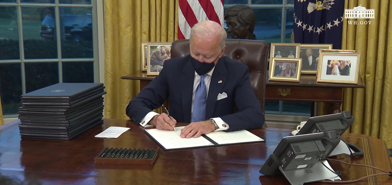 Biden orders aim to achieve 100% clean electricity by 2035
